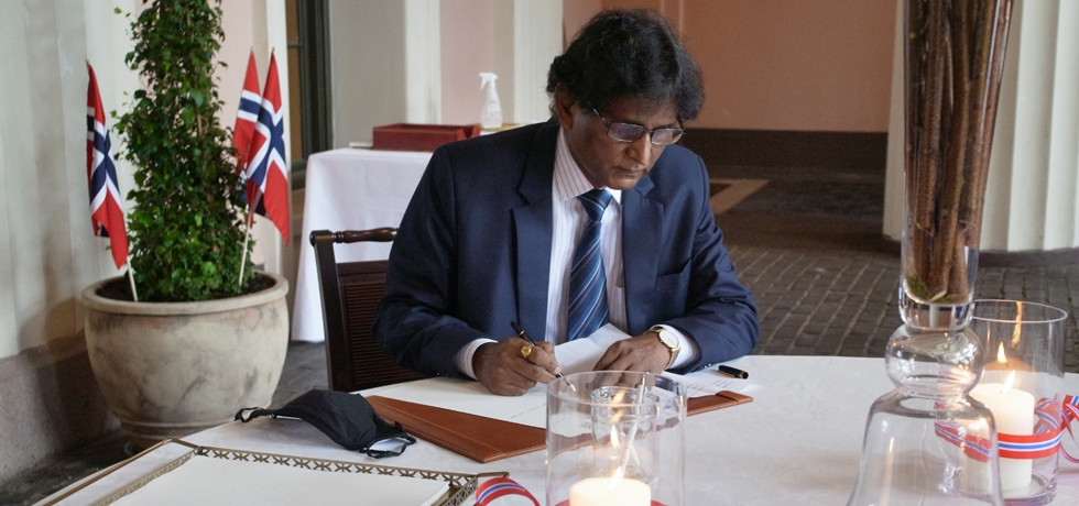 H.E. Dr. B.Bala Bhaskar signing the congratulatory protocol at the Royal Palace on the 207th National Constitution Day of the Kingdom of Norway.